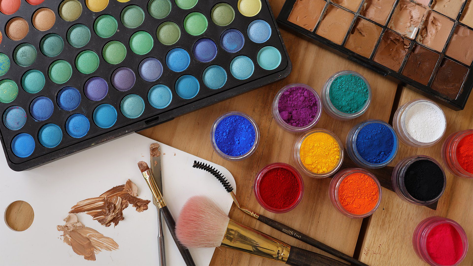 Multiple colours of watercolours with makeup brushes shot on the Canon EOS R & RF 35mm f/1.8 IS Macro STM